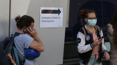 People line up outside the Royal Melbourne Hospital for coronavirus testing earlier this month.