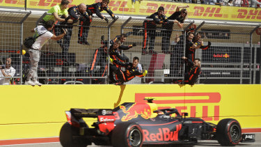 Red Bull team members celebrate Max Verstappen's second place in the US Grand Prix.