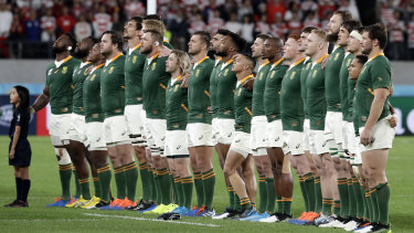 In harmony: South Africa sing their national anthem before their quarter-final against Japan.
