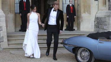 The newly married Duke and Duchess of Sussex, Meghan Markle and Prince Harry, leave Windsor Castle after their wedding.