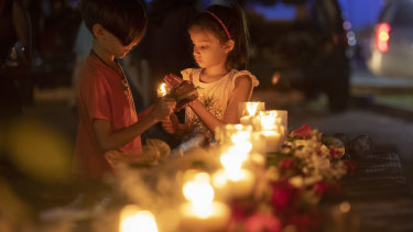 Lucrecia Martinez, 7, and her brother Luciano, 9, of Dickinson light candles during a vigil held in the wake of a deadly school shooting with multiple fatalities at Santa Fe High School in Santa Fe, Texas.