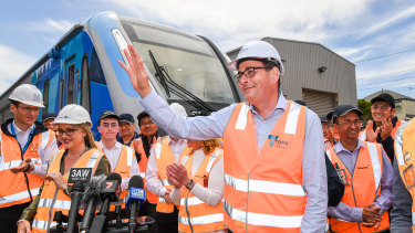 Daniel Andrews unveiled the new CRRC trains at Downer's Newport facility in 2018.