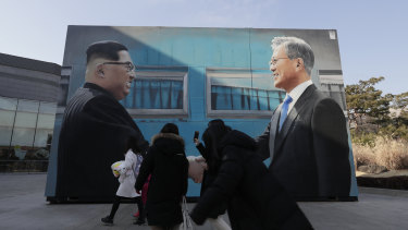 An image of North Korean leader Kim Jong-un and South Korean President Moon Jae-in displayed near the presidential Blue House in Seoul, South Korea.