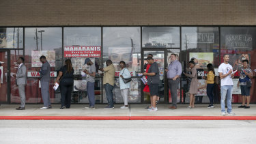 Voting lines in Houston: black voters have to wait twice as long as white voters on average, a study found.