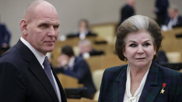 Former wrestler and lawmaker Alexander Karelin, left, and the world's first woman cosmonaut Valentina Tereshkova in the Russian lower house during a vote to extend Vladimir Putin's reign.