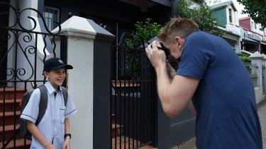 Oscar Bradfield, 12, poses for first-day-of-high-school photos as he heads off to the brand new school, Inner Sydney High.