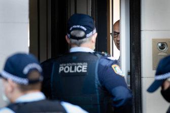 Moses Obeid talks to police at his Paddington home.