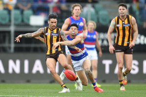 Chad Wingard is tackled by Jason Johannisen.