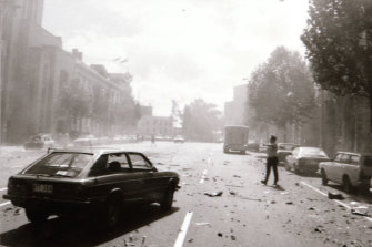 A police officer on the street in the immediate aftermath of the explosion outside of the Russell Steet Police Station in March 1986.