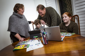 Back to school, at home: Emma Read, partner Paul Moloney and children Hugh, 7, and Bryn, 9.