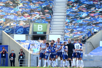 Neal Maupay and his Brighton teammates celebrate his winner against Arsenal.