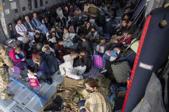 Evacuees sit in a German Bundeswehr airplane in Kabul.