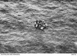 Survivors from the corvette HMAS Armidale adrift on a raft.