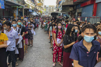 People stand in lines to get COVID-19 tests in Samut Sakhon, South of Bangkok, Thailand, on December 20, 2020.
