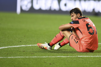 Atalanta keeper Marco Sportiello sits after the team's loss.