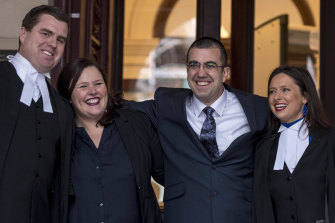 Faruk Orman (in glasses) on the steps of the Supreme Court with his lawyers on Friday.