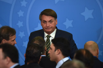 Jair Bolsonaro attends an inauguration ceremony for Andre Mendonca, Brazil's new minister of justice, after former judge and minister Sergio Moro resigned.