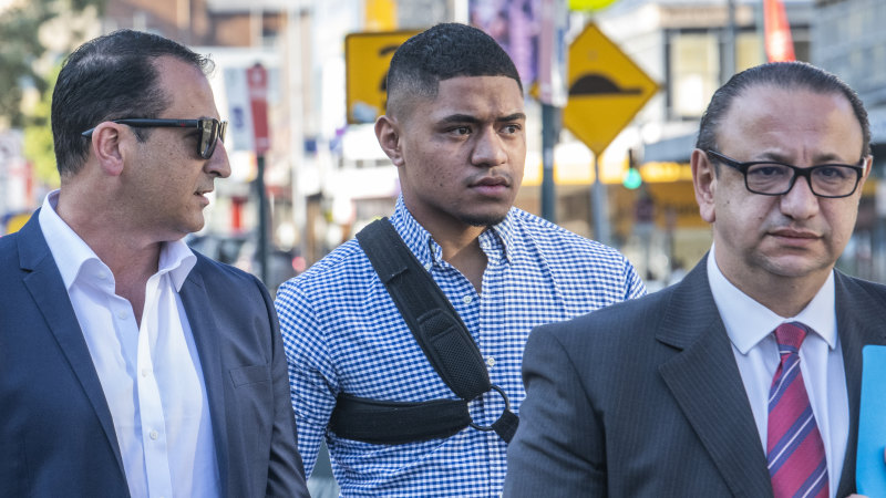 Manly hooker Manase Fainu (centre) is under house arrest  after being hit with three charges relating to an alleged stabbing at a church dance.