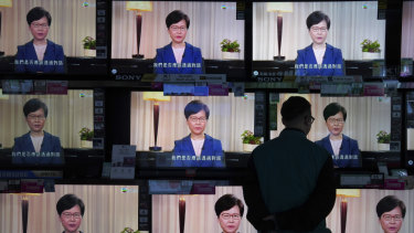 A man watches the television message of Carrie Lam announcing the withdrawal of the extradition bill.