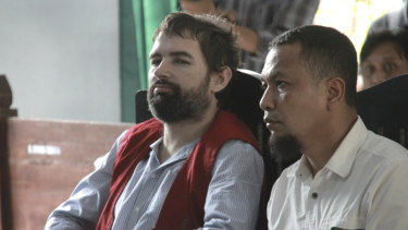 French national Felix Dorfin, left, is accompanied by an interpreter during his sentencing hearing.