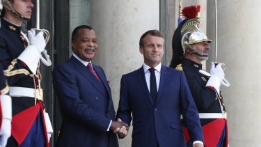 Republic of Congo President Denis Sassou Nguesso, left, is greeted by French President Emmanuel Macron before a meeting at the Elysee Palace in Paris on Tuesday.