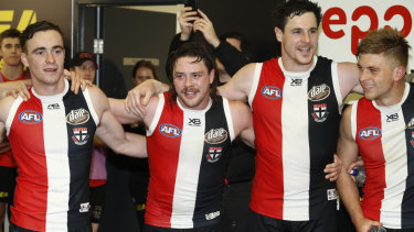 Songs of praise: Jack Steven (second left) with Saints teammates after their tight comeback win over the Dockers.