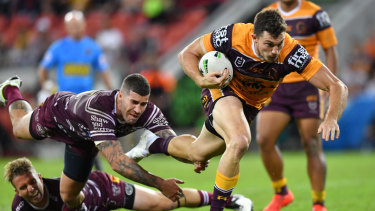 Galloping Bronco: Winger Corey Oates evades the clutches of Manly's Joel Thompson on Friday night.
