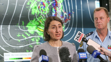 NSW Premier Gladys Berejiklian with State Emergency Service Commissioner Mark Smethurst at the SES headquarters in Wollongong.
