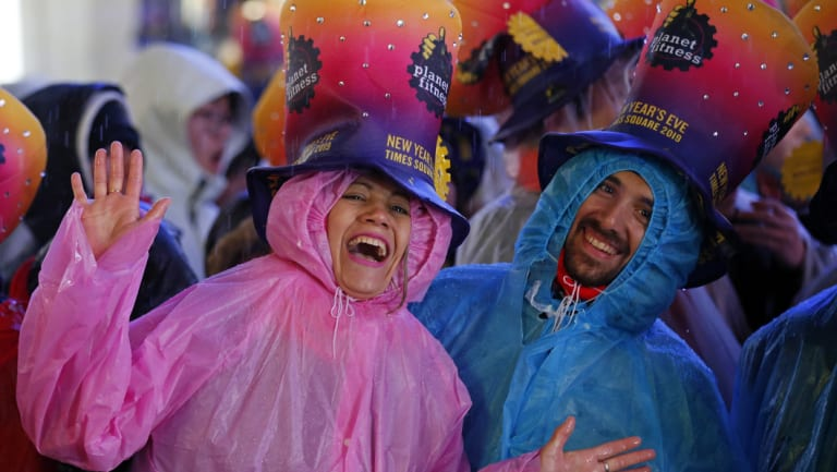 Revellers in rain coats in Times Square, New York City.