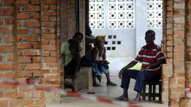 People suspected of having the Ebola virus wait at a treatment centre in Bikoro, Democratic Republic of Congo.