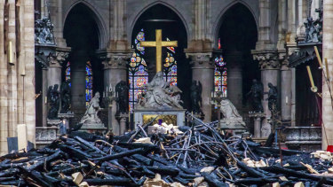 Debris inside Notre-Dame Cathedral as investigators begin a probe into the cause of the fire.