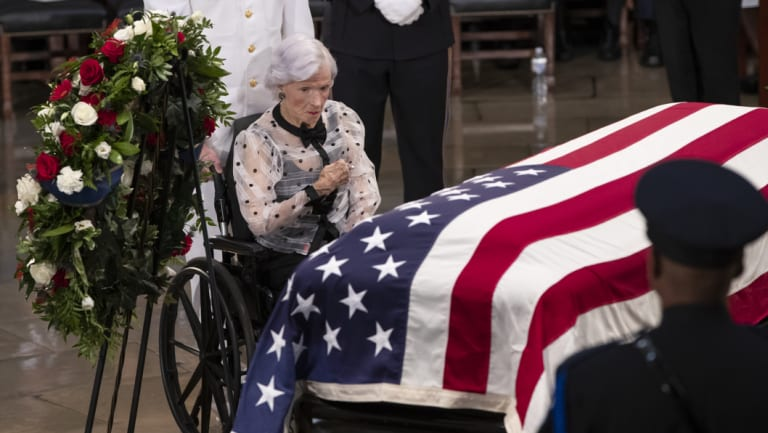 Roberta McCain stops at her son's flag-draped casket in the US Capitol rotunda.