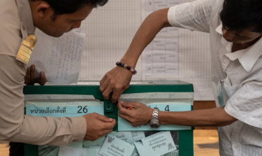 Officials open a sealed ballot box ahead of counting for a general election at a counting centre in Bangkok on Sunday. It was Thailand's first general election since the military seized power five years ago.