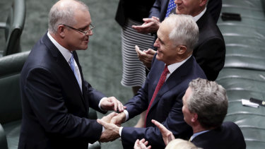 Treasurer Scott Morrison is congratulated by Prime Minister Malcolm Turnbull after delivering the Budget speech.