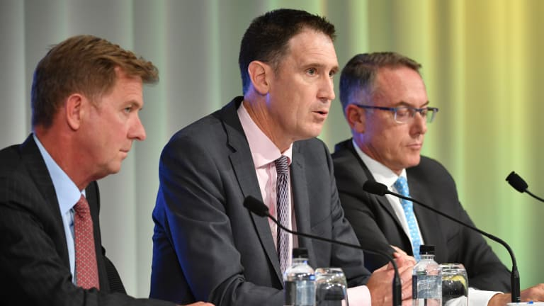 Done deal: Cricket Australia chief James Sutherland, centre, with Seven's Tim Worner and Foxtel's Patrick Delaney.