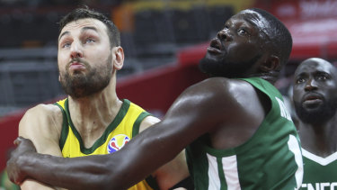 Andrew Bogut in action against Senegal's Youssoupha Ndoye.