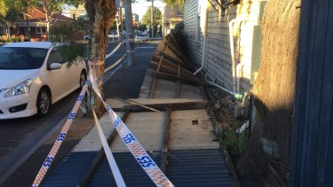 A fence knocked down by wind in Graham Street, Port Melbourne.