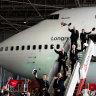 Qantas 747 departs Australia with a flying kangaroo salute