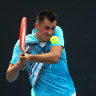 'It's good to be back': Tomic advances after injured opponent retires