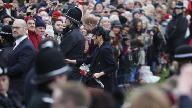Prince Harry and Meghan, Duchess of Sussex meet members of the crowd after the Christmas Day service.