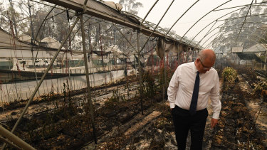 Prime Minister Scott Morrison tours a bushfire-damaged farm in Sarsfield.