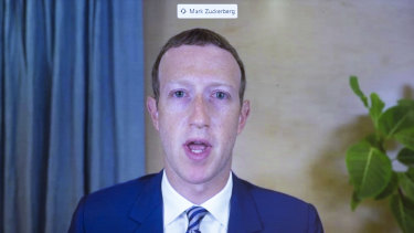 Facebook CEO of Mark Zuckerberg appears on a screen as he speaks remotely during a hearing before the Senate Commerce Committee on Capitol Hill.