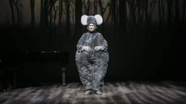 Mandy Bishop looked so cute and sad in a big fat koala suit before a backdrop of charred gum trees that a collective sigh of sympathy passed around the room.