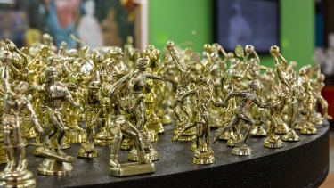 Removed from their plinths, the golden trophy figurines in The Field take on a strange quality.