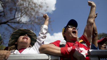 Supporters of Venezuela's President Nicolas Maduro cheer during a government rally in Caracas, Venezuela, on Saturday.