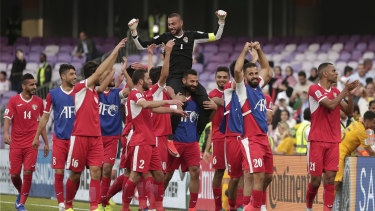 Huge result: Jordan's goalkeeper Amer Shafi, top, and his teammates celebrate their huge upset over the Socceroos.