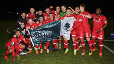 Hume City FC celebrate with the quarter-final flag after defeating Adelaide Olympic last month.