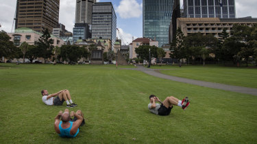 People exercising at the Domain as gyms have closed due to the COVID-19 pandemic.