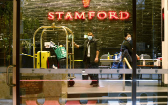 Staff at the Stamford Hotel in Melbourne move luggage for guests in quarantine in June.