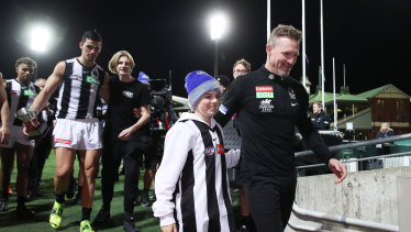 Nathan Buckley celebrates victory with son Ayce Buckley.
